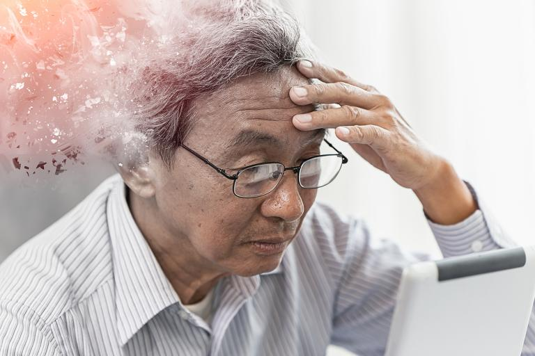 an old man with scattered thoughts trying to read